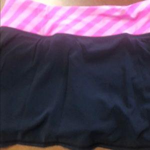 Lululemon black with pink skirt